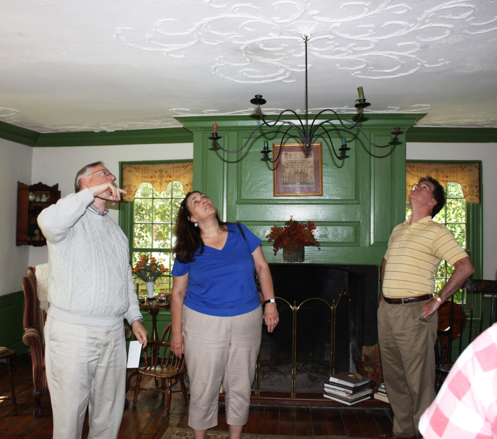 A Host at circa 1742 Buckland points out the original ornate plaster ceiling to visitors